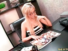 Blonde in glasses masturbates in office tubes