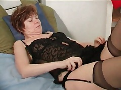 Mature strips from black lingerie to model body tubes