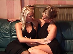Glamorous women in little black dresses strip and play tubes