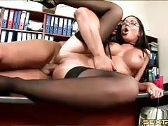Hottie in stockings fucked on his office desk tubes