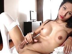 Slim and busty asian shemale jerks off her dick tubes