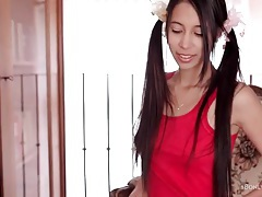 Skinny brunette with long hair in pigtails tubes