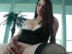 Dark haired shemale beauty with big tits strokes tubes