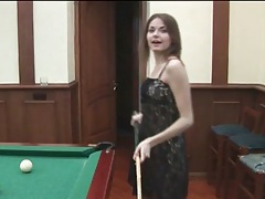 Teen plays pool and models her lovely lingerie tubes