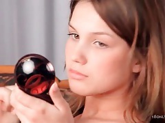 Sheer lingerie teen puts on her makeup tubes