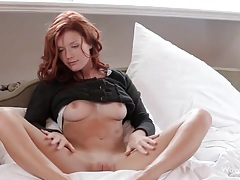Redhead teases us in her sexy sweater tubes