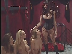 Mistress ties up three big breasted sluts in dungeon tubes