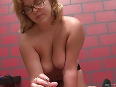 Chunky blonde in glasses gives a handjob tubes