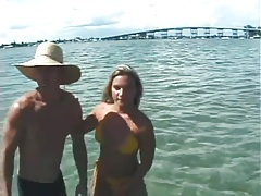 Bikini girl gives him a blowjob in the ocean tubes