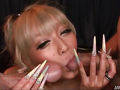 Oiled and tanned girl with long nails sucks cocks tubes