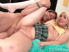 Cute blonde in a short skirt rides cock tubes