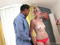 Granny sucks on a massive black cock tubes