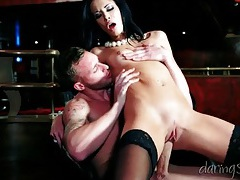 Slut in sexy black stockings sits on a cock tubes