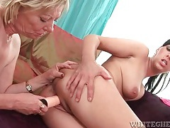 Mature lesbo fucks a toy into younger lover tubes