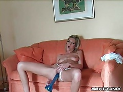Beautiful girl bangs pussy with a dildo tubes