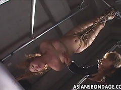Asian bondage scene with rope suspension and forced orgasm tube