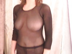 Girl in fishnet body stocking is sexy sucking dick tubes