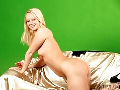 Cute young blonde in black high heels tubes