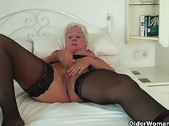 Curvy granny in black stockings rubs her old clit tubes