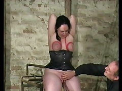 Curvy girl in tight black corset has bound tits tubes