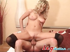 Sexy blonde in black stockings sits on cock tubes