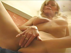 Finger fucking blonde beauty in her bathroom tubes