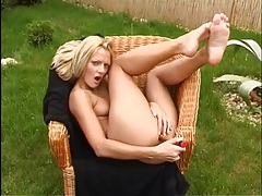Tiny titty girl outdoors rubs her shaved pussy tubes