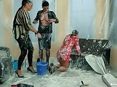 Three women completely covered in messy goo tubes
