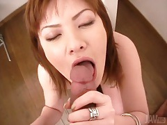 Cumshot in her pretty japanese mouth tubes