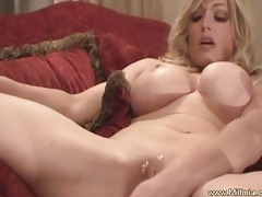 Milf lays on table and squirts tubes
