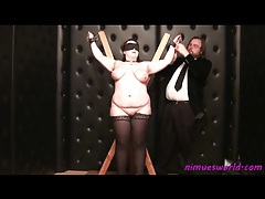 Fat girl in stockings is tied up and played with tubes