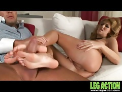 Rock hard cock gets a hot footjob from her tubes