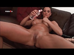 She coats her body in sexy oil and fucks hole with toy tubes