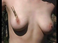 Close up on clothes pins biting into her tits tubes