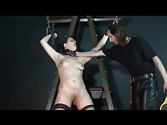Girl in collar and bondage wears stockings tubes