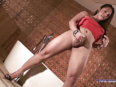 Maffie in red lingerie stroking her cock tubes