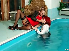 Girl on a leash has fun in the pool with mistress tubes