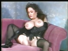 Black lingerie and satin gloves on this busty solo girl tubes