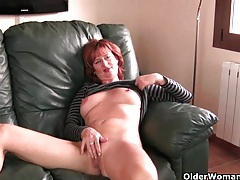 Redheaded mature mom plays with her nipples and pussy tubes