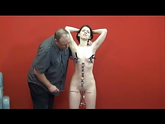 Pulling clothes pins off her skinny naked body tubes
