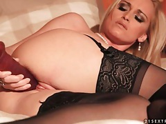 Gorgeous blonde erotically fucks pussy with toy tubes