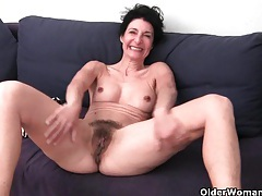 Hairy granny has a wet spot in her panties tubes