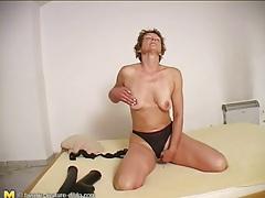Cute milf masturbates pussy with big toy tubes