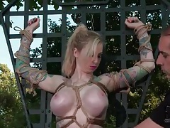 Busty girl bound and submerged in water outdoors tubes
