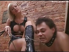 Mistress in black latex is rough with him tubes