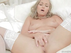 Erotic tease in white satin and dreamy white stockings tubes