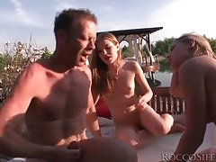 Sunset fuck with two sluts ends in shared cumshot tubes