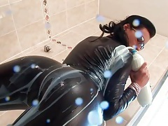 She turns him on with a skintight leather catsuit tubes