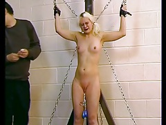 Small tits blonde in bondage likes hot wax pain tubes