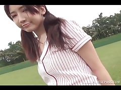 Young and sporty japanese girl on the field tubes